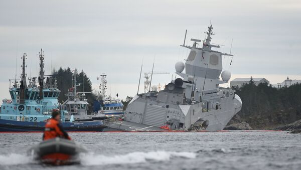 The Norwegian frigate KNM Helge Ingstad takes on water after a collision with the tanker Sola TS in Oygarden, Norway, November 8, 2018 - Sputnik International