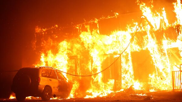 A structure is seen engulfed in flames during the Camp Fire in Paradise - Sputnik International