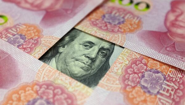 A US 100-dollar banknote with a portrait of Benjamin Franklin and Chinese 100-yuan banknotes with portrait of late Chinese Chairman Mao Zedong are seen in the picture illustration in Beijing, China - Sputnik International