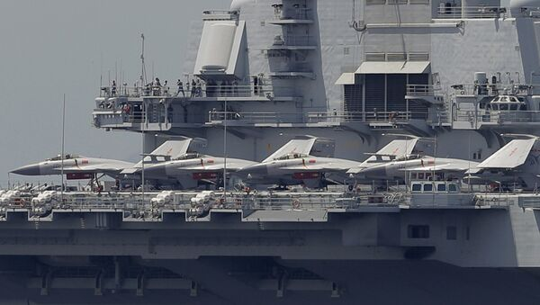 The Liaoning, China's first aircraft carrier, departs Hong Kong - Sputnik International