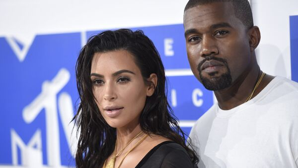 Kim Kardashian West, left, and Kanye West arrive at the MTV Video Music Awards at Madison Square Garden on Sunday, Aug. 28, 2016, in New York. - Sputnik International