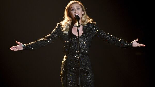 Miley Cyrus performs onstage at the 2018 MusiCares Person of the Year tribute honoring Fleetwood Mac at Radio City Music Hall on Friday, Jan. 26, 2018, in New York. - Sputnik International