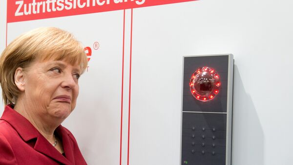 German Chancellor Angela Merkel grimaces as access is denied to her at the stand of security equipment maker tisoware during her opening tour of the CeBIT computer fair in Hannover, northern Germany, Tuesday, March 5, 2013. - Sputnik International