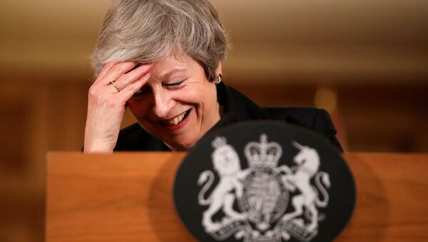Britain's Prime Minister Theresa May reacts during a news conference at Downing Street in London, Britain November 15, 2018 - Sputnik International