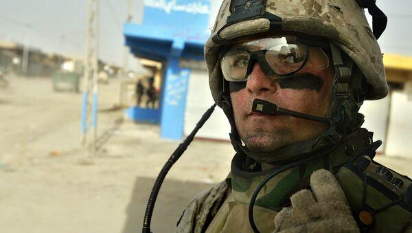 U.S. Marine Sgt. Derek McGee, of Rhinebeck, New York, speaks into his radio during a patrol in Fallujah, the site of the largest U.S. battle in Iraq, 65 kilometers (40 miles), west of Baghdad, Iraq, Monday, May 1, 2006 - Sputnik International