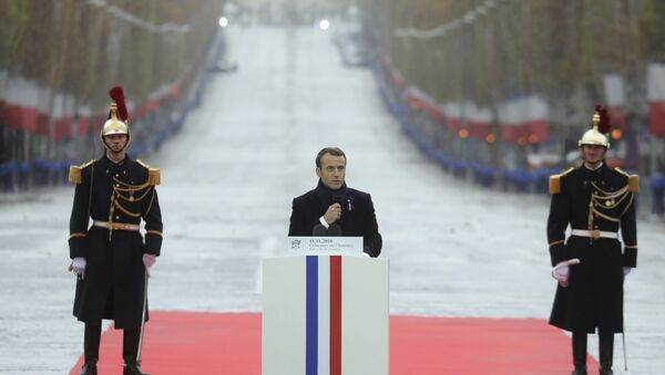 French President Emmanuel Macron delivers a speech during a ceremony at the Arc de Triomphe in Paris as part of the commemorations marking the 100th anniversary of the 11 November 1918 armistice, ending World War I, Sunday, Nov. 11, 2018 - Sputnik International