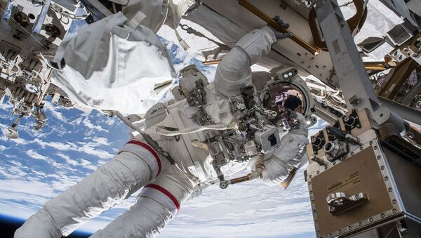 NASA astronaut Drew Feustel seemingly hangs off the International Space Station while conducting a spacewalk with fellow NASA astronaut Ricky Arnold (out of frame) on March 29, 2018. Feustel, as are all spacewalkers, was safely tethered at all times to the space station during the six-hour, ten-minute spacewalk. - Sputnik International
