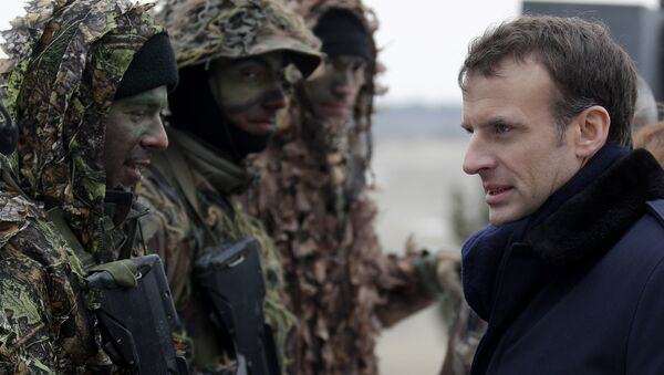 French President Emmanuel Macron inspects sniper squad as he attends a military exercise at the military camp of Suippes, near Reims, eastern France, Thursday, March 1, 2018 - Sputnik International