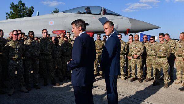 British Defence Minister Gavin Williamson (L) and his Romanian counterpart Mihai Fifor (R), meet with the British pilots and technical staff serving the four British Air Force Typhoons and the Romanian military personnel at Mihail Kogalniceanu 57 Air Base near Constanta, Romania on August 2, 2018. - Sputnik International