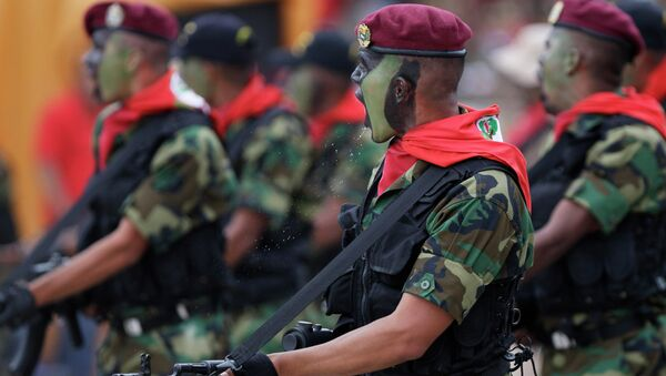 Soldiers march during a military parade commemorating the 20th anniversary of the failed coup attempt by President Hugo Chavez in Caracas, Venezuela - Sputnik International