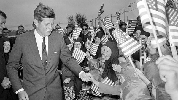 U.S. President John F. Kennedy is greeted by an enthusiastic crowd of children and nuns from the Convent of Mercy, as he arrives from Dublin by helicopter at Galway's sports ground, Ireland, June 29, 1963.  - Sputnik International