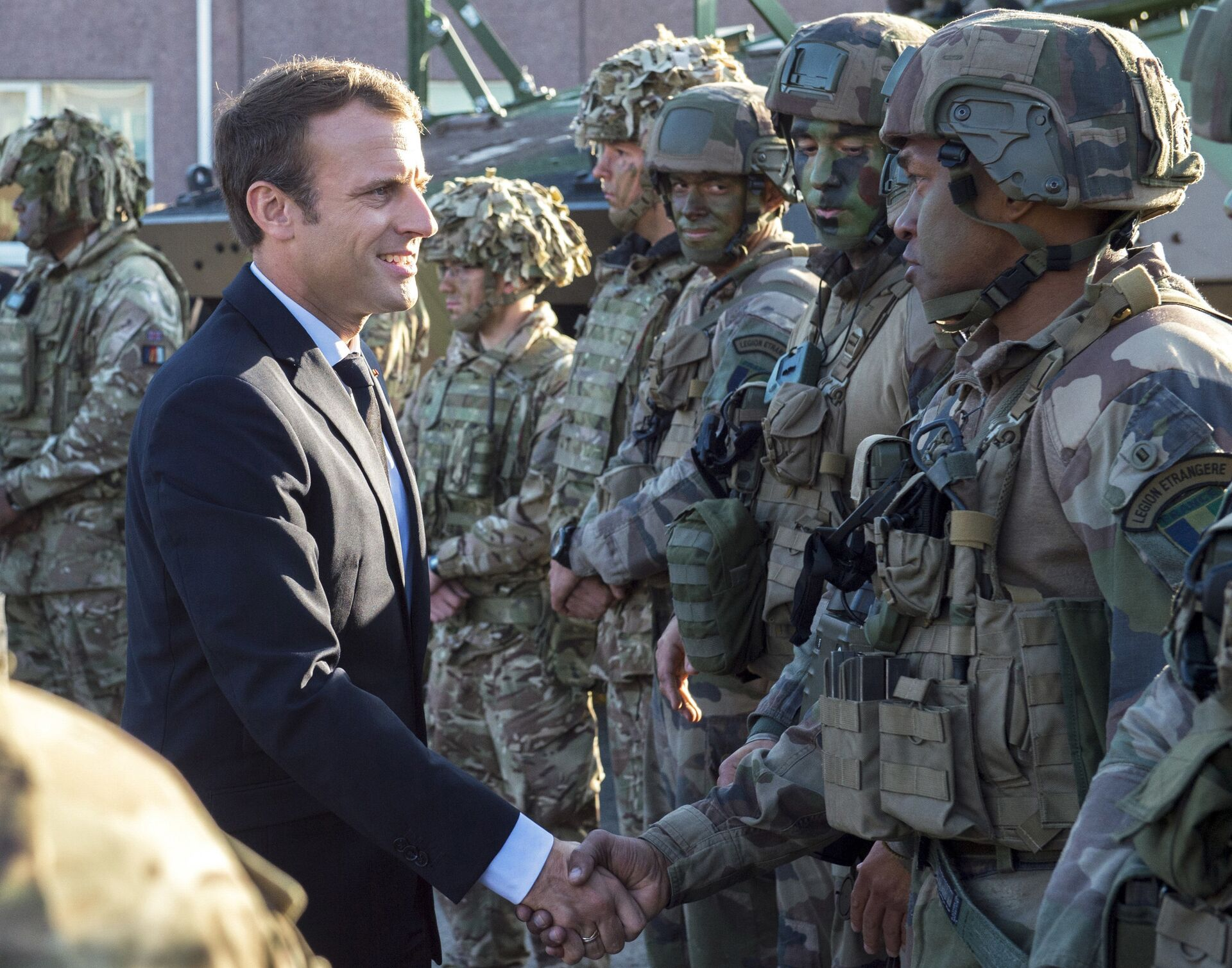 FILE - In this Friday, Sept. 29, 2017 file photo, France's President Emmanuel Macron, left, shakes hands with French soldiers of the NATO Battle Group at the Tapa military base, about 90 kilometers (56 miles) west of Tallinn, Estonia - Sputnik International, 1920, 28.09.2021