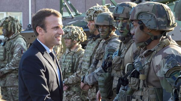 FILE - In this Friday, Sept. 29, 2017 file photo, France's President Emmanuel Macron, left, shakes hands with French soldiers of the NATO Battle Group at the Tapa military base, about 90 kilometers (56 miles) west of Tallinn, Estonia - Sputnik International