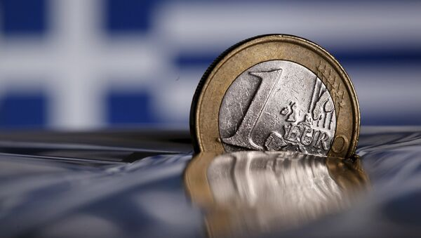 A one Euro coin is seen in this file photo illustration taken in Rome, Italy - Sputnik International