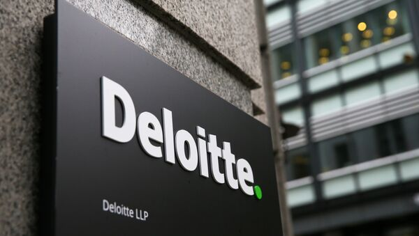 A Deloitte logo is pictured on a sign outside the company's offices in London on September 25, 2017 - Sputnik International