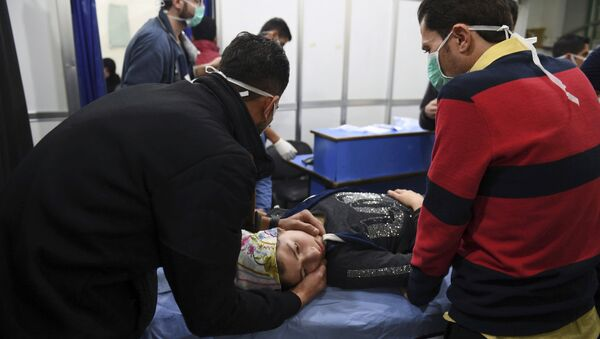 In this photo released by the Syrian official news agency SANA, a woman receives treatment at a hospital following a suspected poison gas attack on her town of al-Khalidiya, in Aleppo, Syria, Saturday, Nov. 24, 2018. - Sputnik International