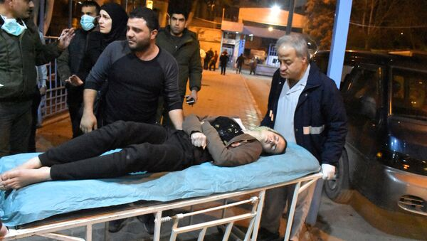 A woman lies on a stretcher after what the Syrian state media said was a suspected toxic gas attack in Aleppo, Syria November 24, 2018 - Sputnik International