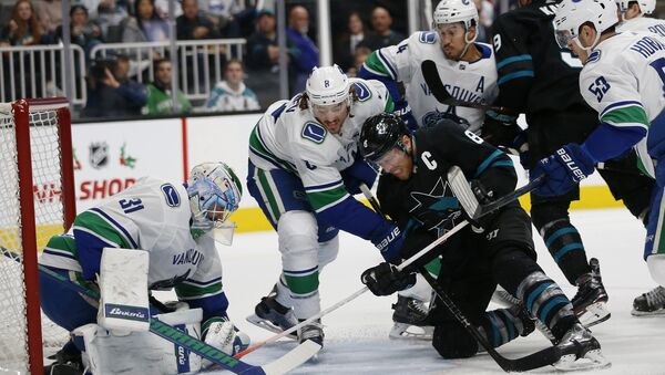 Vancouver Canucks' Anders Nilsson (31) makes a save against San Jose Sharks' Joe Pavelski (8) with the help of Canucks' Christopher Tanev (8) and Michael Del Zotto (4) during the first period of an NHL hockey game in San Jose, Calif., Friday, Nov. 23, 2018 - Sputnik International