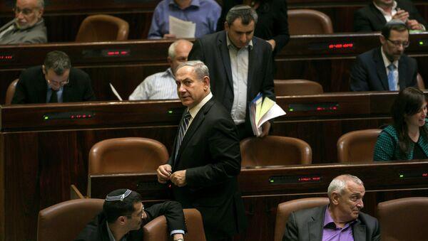 Israel's Prime Minister Benjamin Netanyahu leaves after a vote to dissolve the Israeli parliament, also known as the Knesset, in Jerusalem December 8, 2014 - Sputnik International
