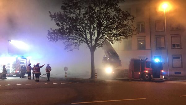 Firefighters are seen in front of a house where six people were killed in an apartment fire early on Monday morning, police said, while an unspecified number of others caught in the blaze were taken to the hospital in Solothurn, Switzerland November 26, 2018 - Sputnik International