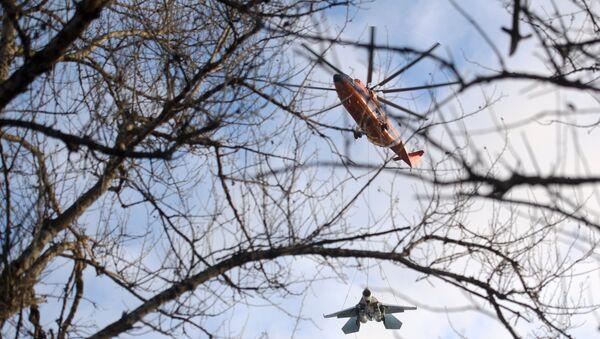 Mi-26 Helicopter Hauling Around 15-Tonne Su-27 Fighter - Sputnik International