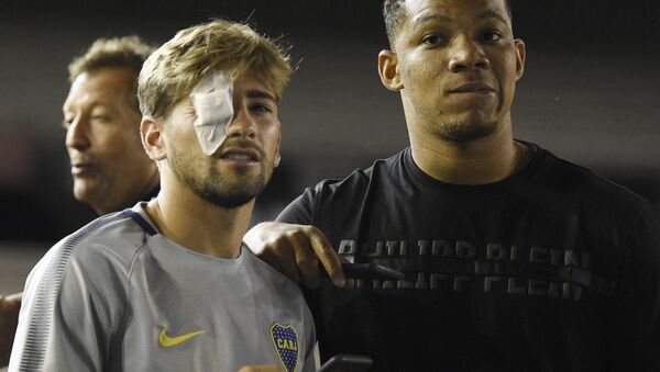 Gonzalo Lamardo was one of two Boca Juniors players who had glass shards embedded in their eye after the incident - Sputnik International