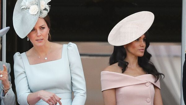 Britain's Kate, the Duchess of Cambridge, left, and Meghan, the Duchess of Sussex attend the annual Trooping the Colour Ceremony in London, Saturday, June 9, 2018.(AP Photo/Frank Augstein) - Sputnik International
