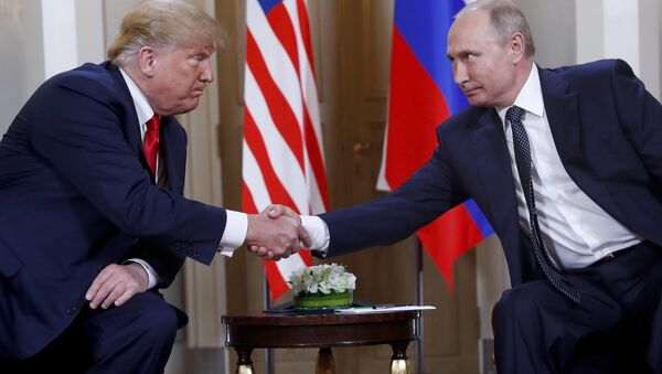 In this file photo taken on 16 July 2018, US President Donald Trump and Russian President Vladimir Putin shake hands at the beginning of a meeting at the Presidential Palace in Helsinki, Finland. - Sputnik International