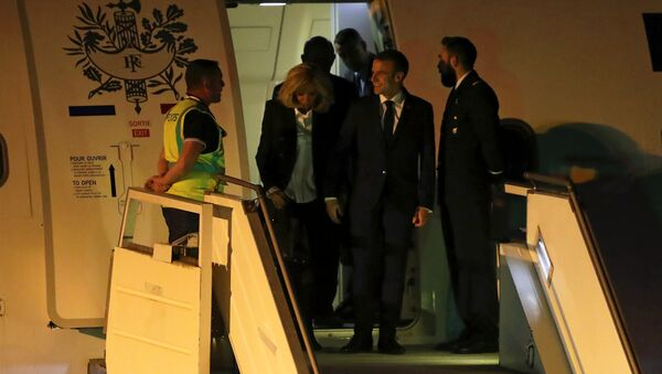 French President Emmanuel Macron and his wife Brigitte Macron arrive at Ministro Pistarini International Airport for the G20 leaders summit in Buenos Aires, Argentina November 28, 2018 - Sputnik International