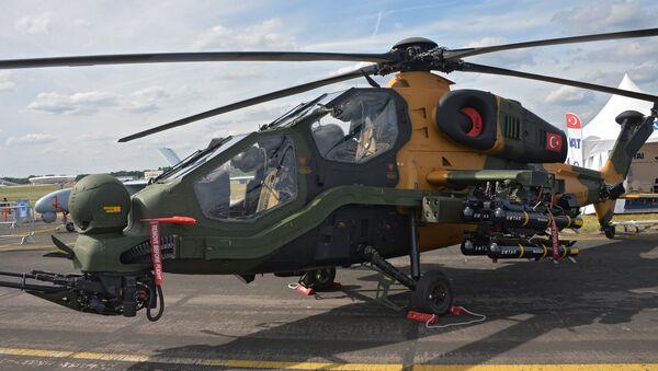 Turkish T129 ATAK chopper at an arms expo in 2014. - Sputnik International