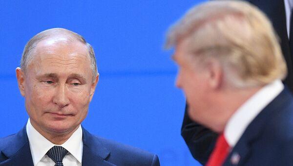 Russian President Vladimir Putin and US President Donald Trump before a photo op of the G20 heads, November 30, 2018. - Sputnik International