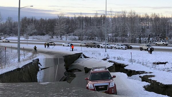 A car is trapped on a collapsed section of the offramp of Minnesota Drive in Anchorage, Friday, Nov. 30, 2018. - Sputnik International