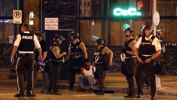 Police detain a man after a earlier peaceful protest in response to a not guilty verdict in the trial of former St. Louis police officer Jason Stockley turned violent Sunday, Sept. 17, 2017, in St. Louis. - Sputnik International
