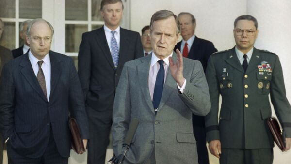 In this Feb. 11, 1991, file photo, President George H.W. Bush talks to reporters in the Rose Garden of the White House after meeting with top military advisors to discuss the Persian Gulf War - Sputnik International
