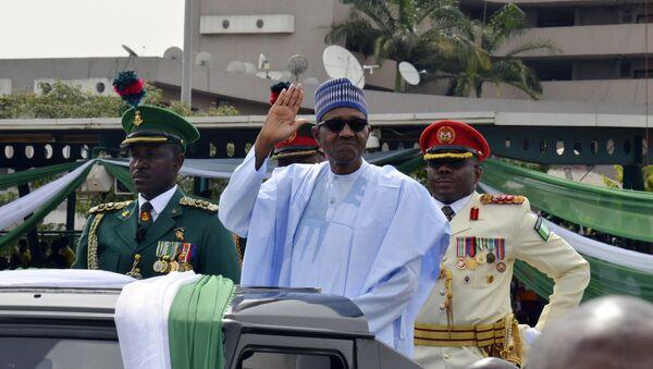 Nigerian President, Muhammadu Buhari, waves to the crowd during the 58th anniversary celebrations of Nigerian independence, in Abuja, Nigeria, Monday, Oct. 1, 2018 - Sputnik International