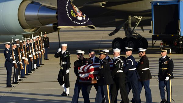 Casket of former President George H.W. Bush is carried by a joint services military honor guard to a hearse at Andrews Air Force Base in Maryland - Sputnik International