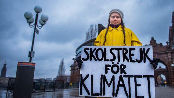 15-year-old Swedish girl Greta Thunberg holds a placard reading School strike for the climate during a manifestation against climate change outside the Swedish parliament in Stockholm, Sweden November 30, 2018 - Sputnik International