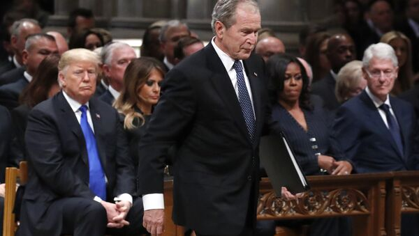 Former President George W. Bush walks past President Donald Trump, first lady Melania Trump, Michelle Obama and former President Bill Clinton to give a eulogy for his father - Sputnik International