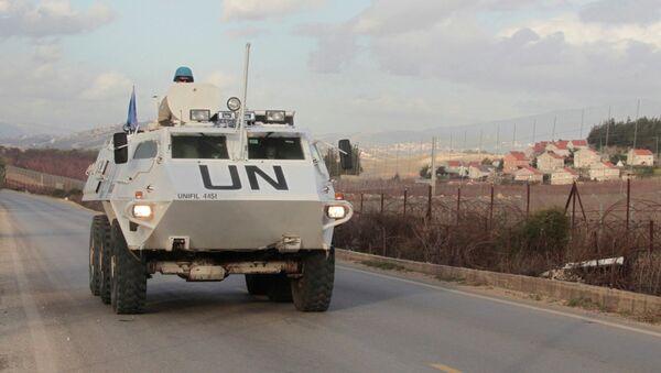 U.N. peacekeepers of the United Nations Interim Force in Lebanon (UNIFIL) patrol in Kfar Kila village in south Lebanon, near the border with Israel - Sputnik International