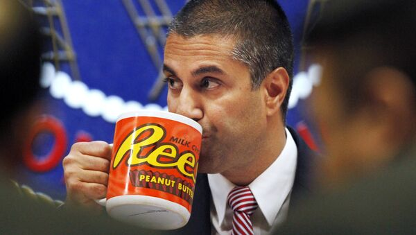 Federal Communications Commission (FCC) Chairman Ajit Pai takes a drink from a mug during an FCC meeting where the FCC voted on net neutrality, in Washington.  - Sputnik International