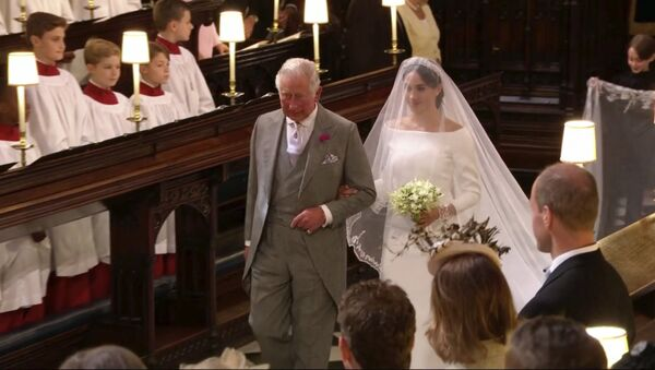 In this frame from video, Meghan Markle walks down the aisle with Prince Charles for her wedding ceremony at St. George's Chapel in Windsor Castle in Windsor, near London, England, Saturday, May 19, 2018. - Sputnik International