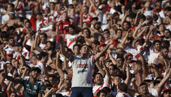 River Plate fans ahead of the second leg of the Copa Libertadores final, which is being played in Madrid on December 9 - Sputnik International