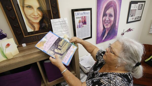 In this Monday, Aug. 6, 2018 photo, Susan Bro, mother of Heather Heyer, who was killed during the Unite the Right rally last year, looks over memorabilia in her office in Charlottesville, Va - Sputnik International