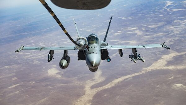 An F/A-18C receives fuel from a KC-10 Extender, one of the refueling aircraft belonging to US Central Command. - Sputnik International