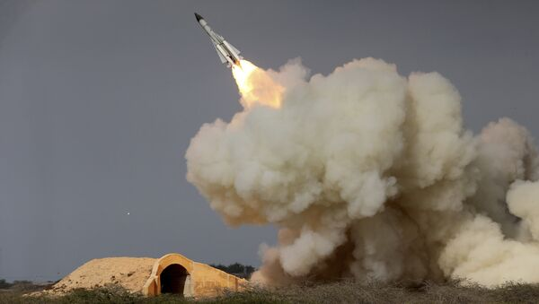 In this Dec. 29, 2016 file photo, released by the semi-official Iranian Students News Agency (ISNA), a long-range S-200 missile is fired in a military drill in the port city of Bushehr, on the northern coast of Persian Gulf, Iran - Sputnik International
