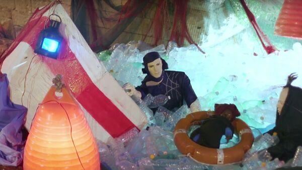 Nativity scene with migrants trapped in plastic sea sparks controversy - Sputnik International