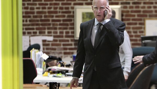 Governor Jerry Brown is seen on the phone after Tuesday's election at his campaign headquarters in Oakland, Calif. (File) - Sputnik International