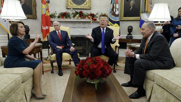 President Donald Trump and Vice President Mike Pence meet with Senate Minority Leader Chuck Schumer, D-N.Y., and House Minority Leader Nancy Pelosi, D-Calif., in the Oval Office of the White House, Tuesday, Dec. 11, 2018, in Washington. - Sputnik International