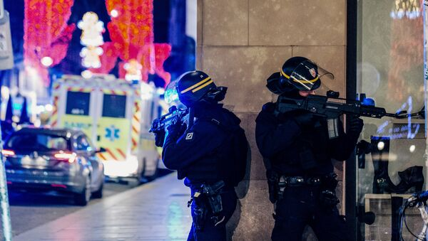 French police officers stand guard near the scene of a shooting on December 11, 2018 in Strasbourg, eastern France. - Sputnik International