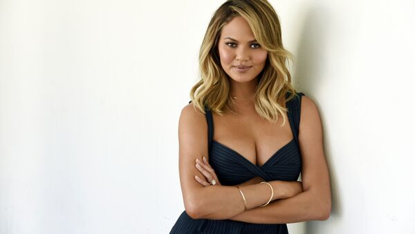 Chrissy Teigen, one of the hosts of the lifestyle talk show FABLife, poses for a portrait during the 2015 Television Critics Association Summer Press Tour at the Beverly Hilton on Tuesday, Aug. 4, 2015, in Beverly Hills, Calif.  - Sputnik International